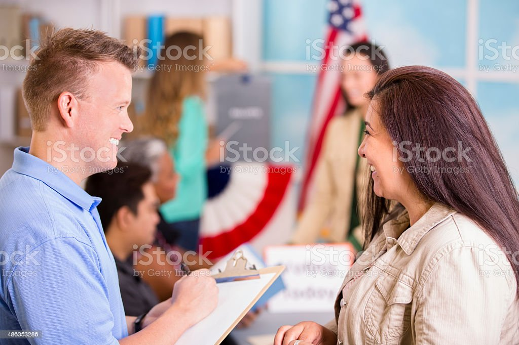 Volunteer helps people register to vote in November USA elections. stock photo