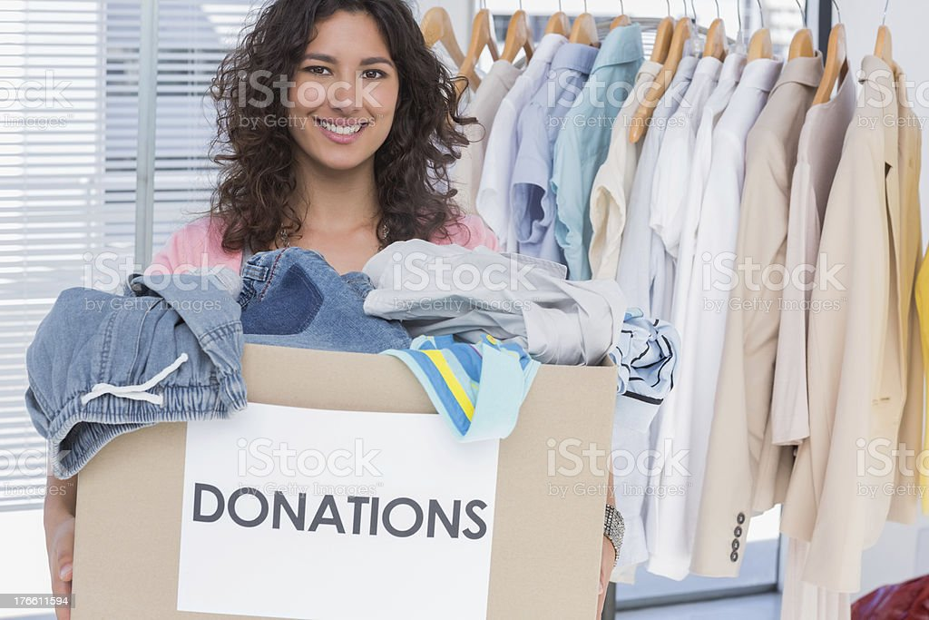 Volunteer holding clothes donation box stock photo
