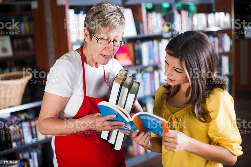 Volunteer Librarian Helping Student stock photo