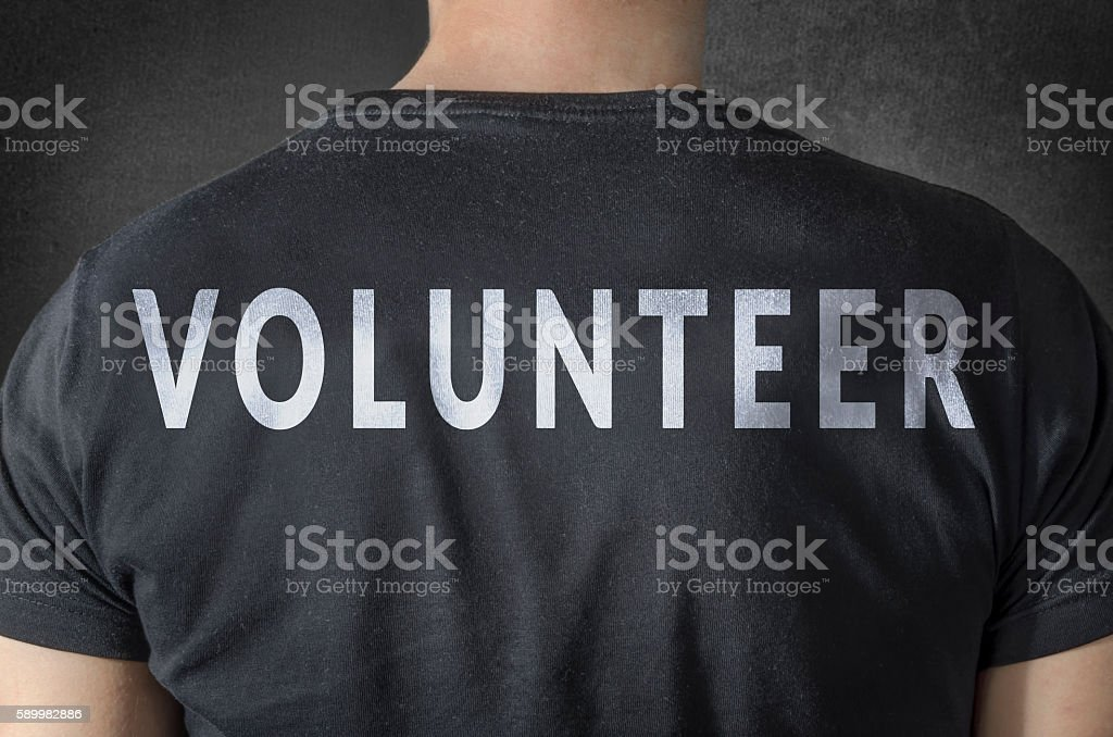 Volunteer tittle on black t-shirt. Back view. stock photo