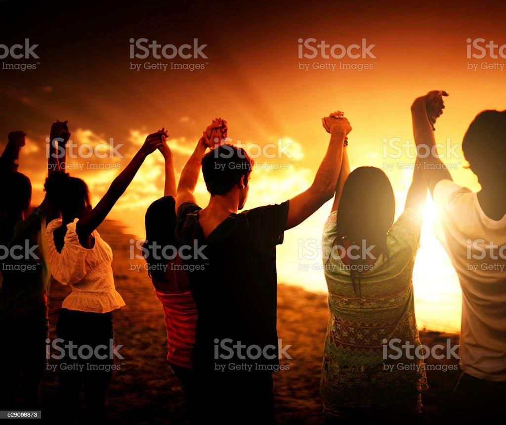 volunteer togetherness at dusk stock photo