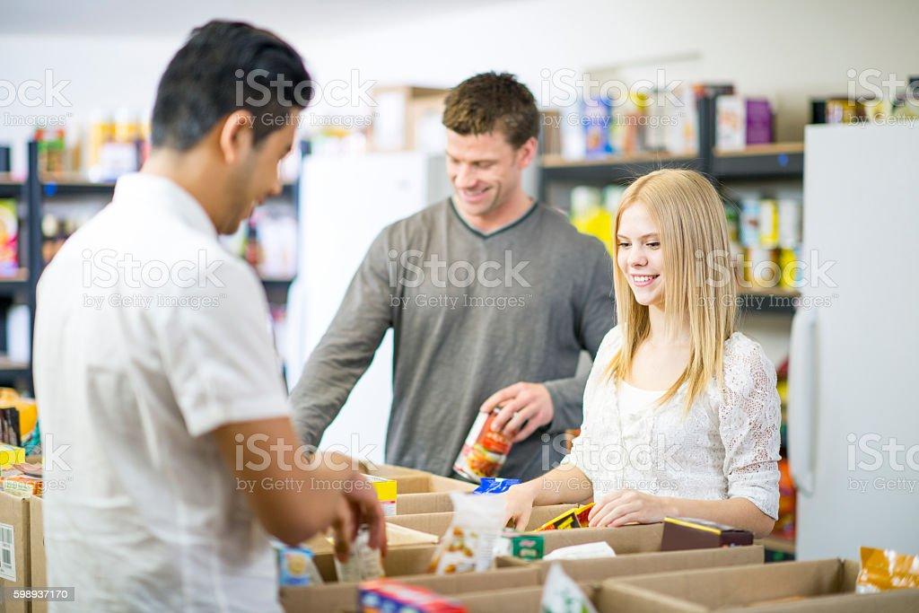 Volunteering at a Food Bank stock photo