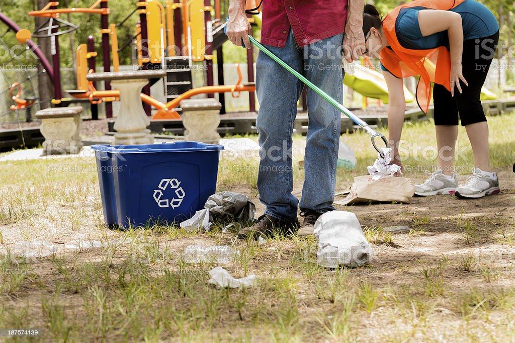 Volunteerism: Neighbors pick up litter in local park. Environmental awareness. stock photo