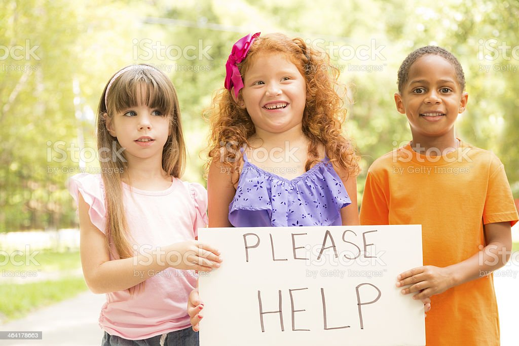 Volunteerism:  Three cute children hold a 'Thank You' sign. Charity. stock photo