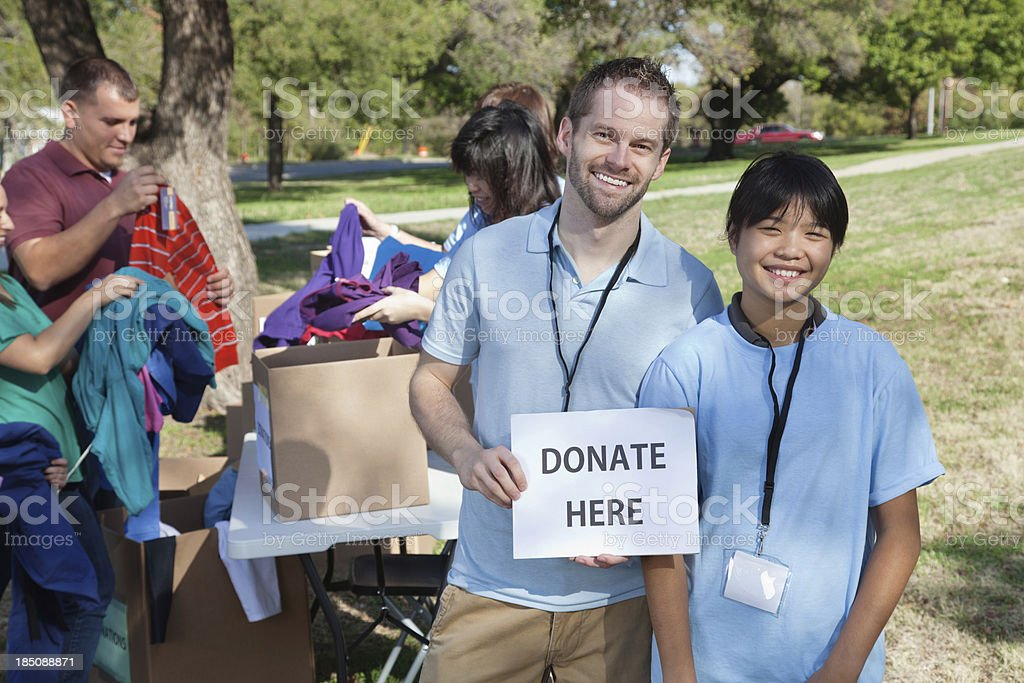 Volunteers at donation center collecting donations royalty-free stock photo