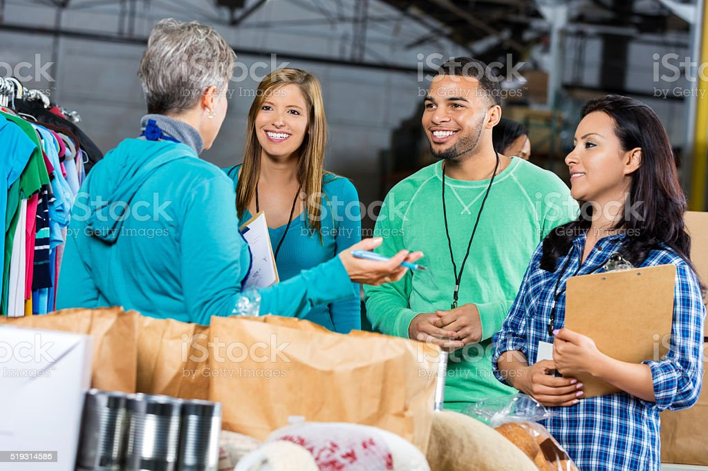 Volunteers at food and clothing drive stock photo