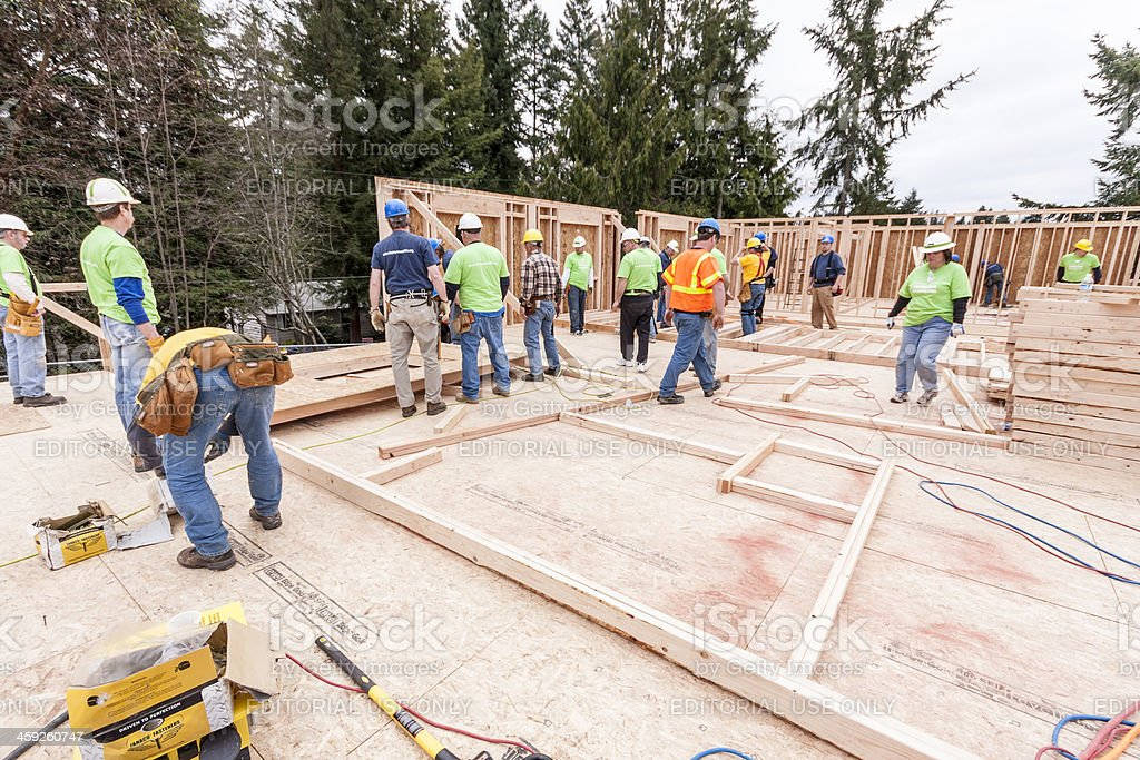 Volunteers build homeless women and children shelter royalty-free stock photo