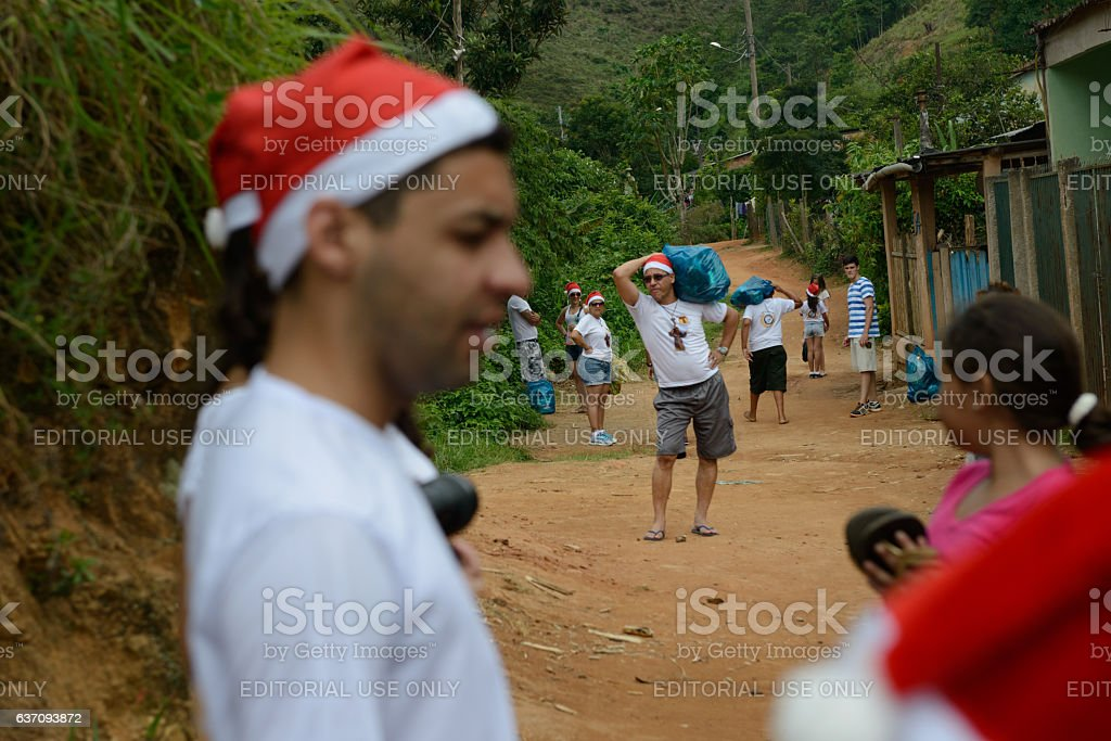 Volunteers carrying Christmas gifts stock photo