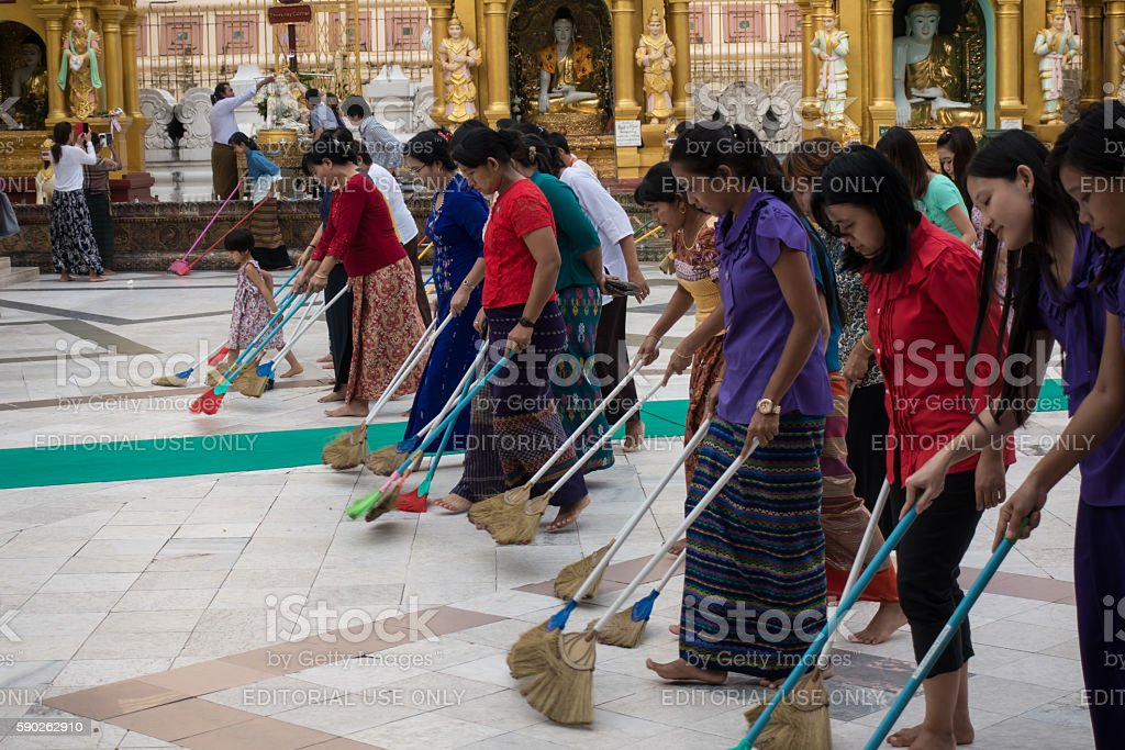 Volunteers cleaning the floor stock photo