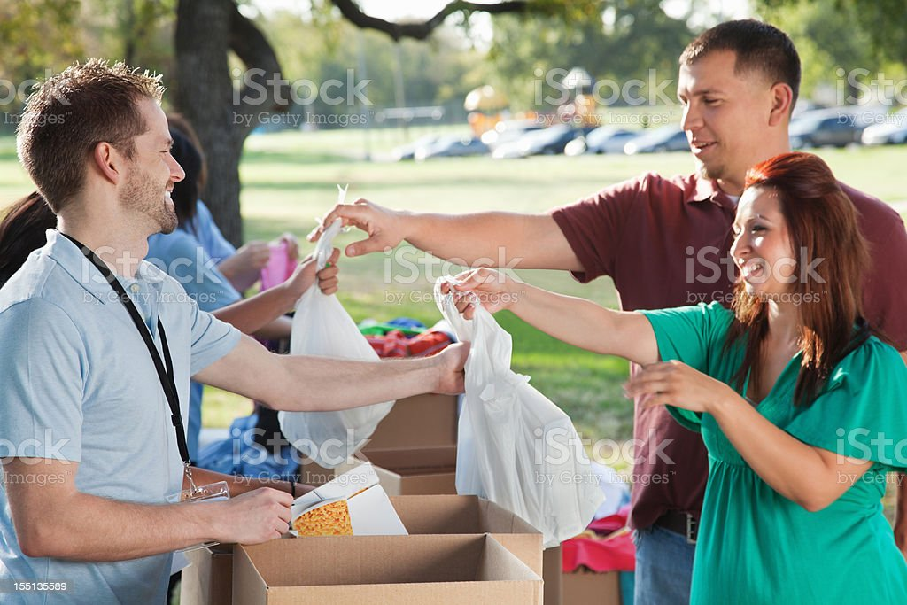 Volunteers collecting donations from donors at a donation center stock photo