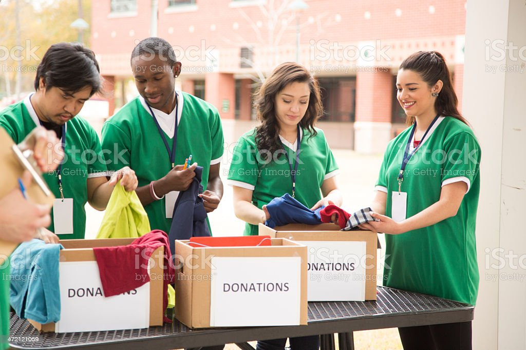 Volunteers: College students collect clothing donations for community. stock photo