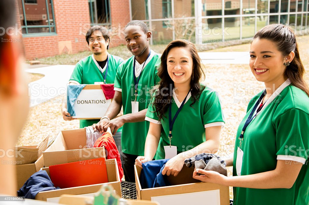 Volunteers: College students collect clothing donations for community. royalty-free stock photo