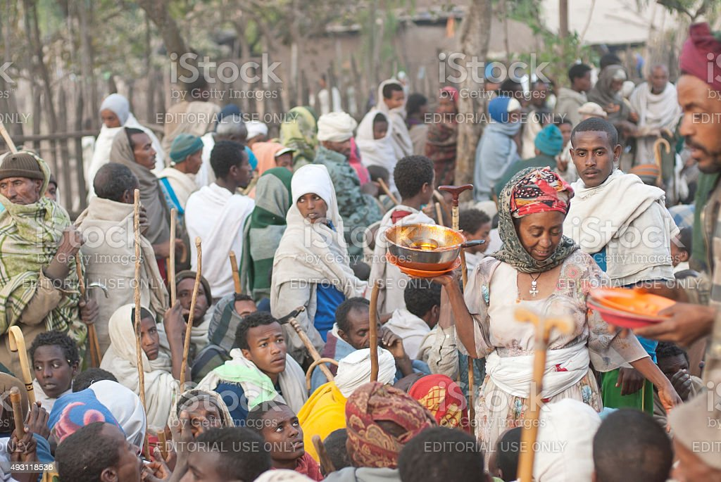 Volunteers hand out food after celebration of Christmas, Lalibela, Ethiopia. stock photo