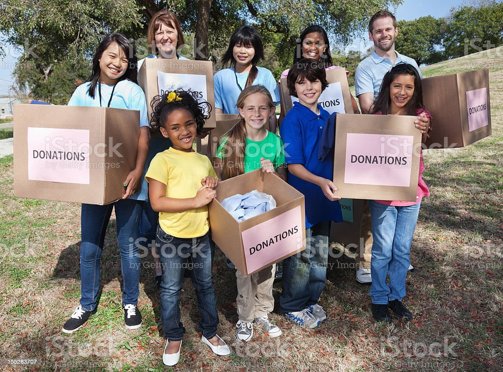 Volunteers holding boxes of donations royalty-free stock photo