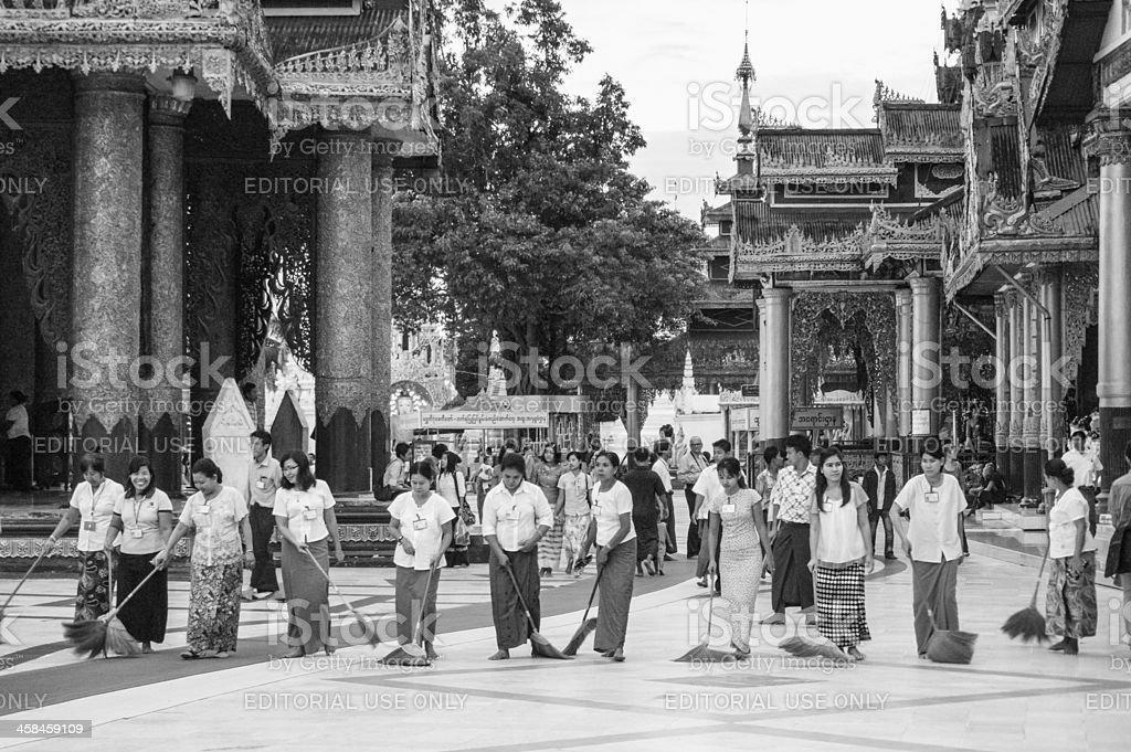 Volunteers in Shwedagon Pagoda, Yangon, Myanmar royalty-free stock photo