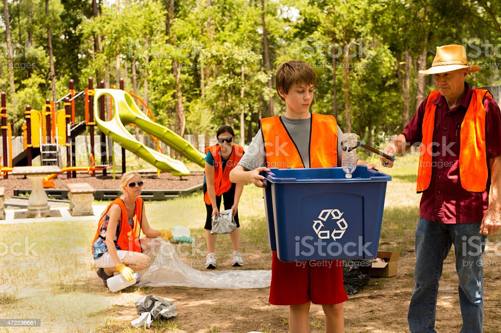 Volunteers: Neighbors clean up their community park. stock photo