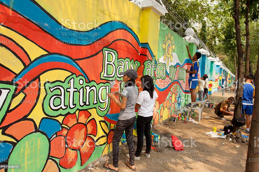 Volunteers painting the wall with peace mural stock photo