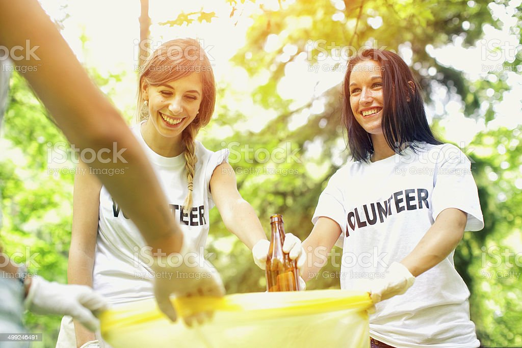 Volunteers picking up garbage stock photo