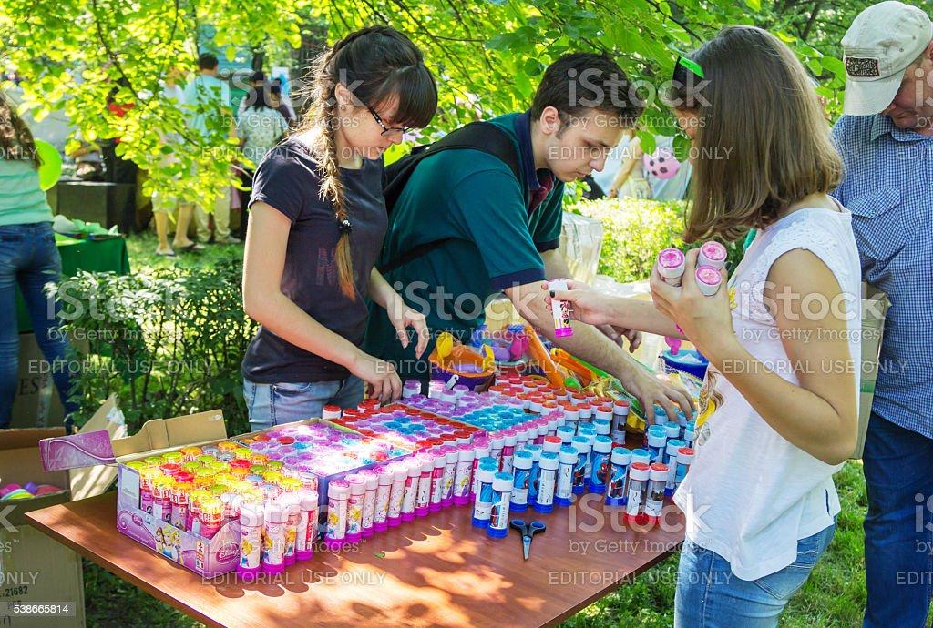 volunteers preparing presents for children stock photo