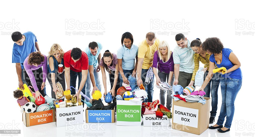 Volunteers put things in a donation boxes. royalty-free stock photo