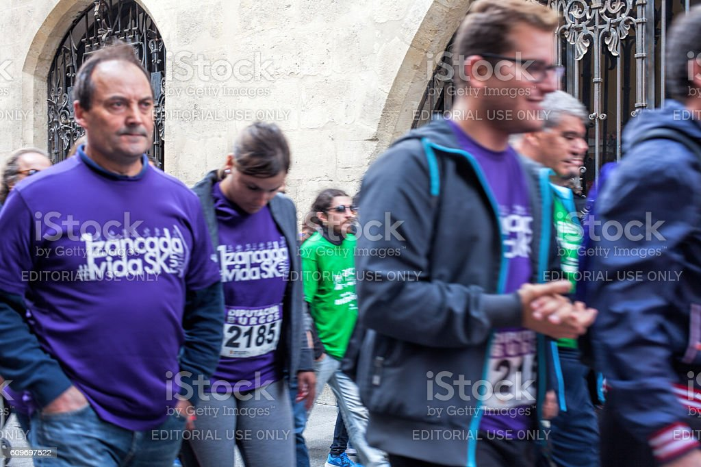 Volunteers taking part in anti-cancer march stock photo