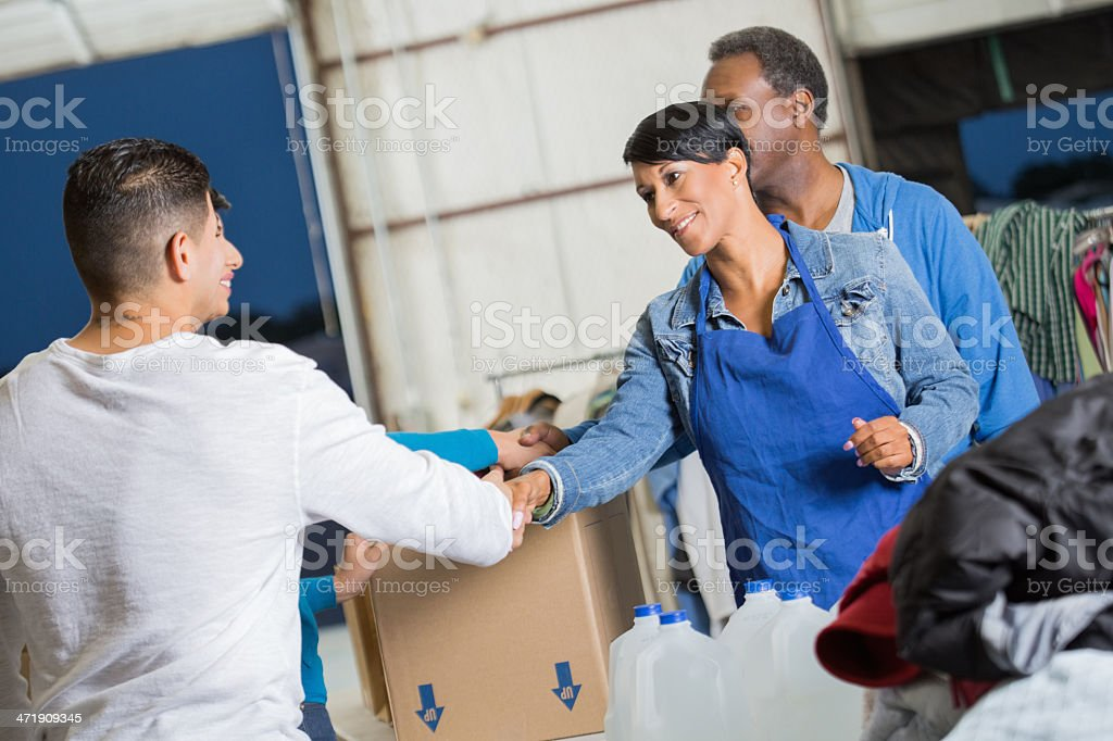 Volunteers thanking people as they donate clothes to disaster relief stock photo