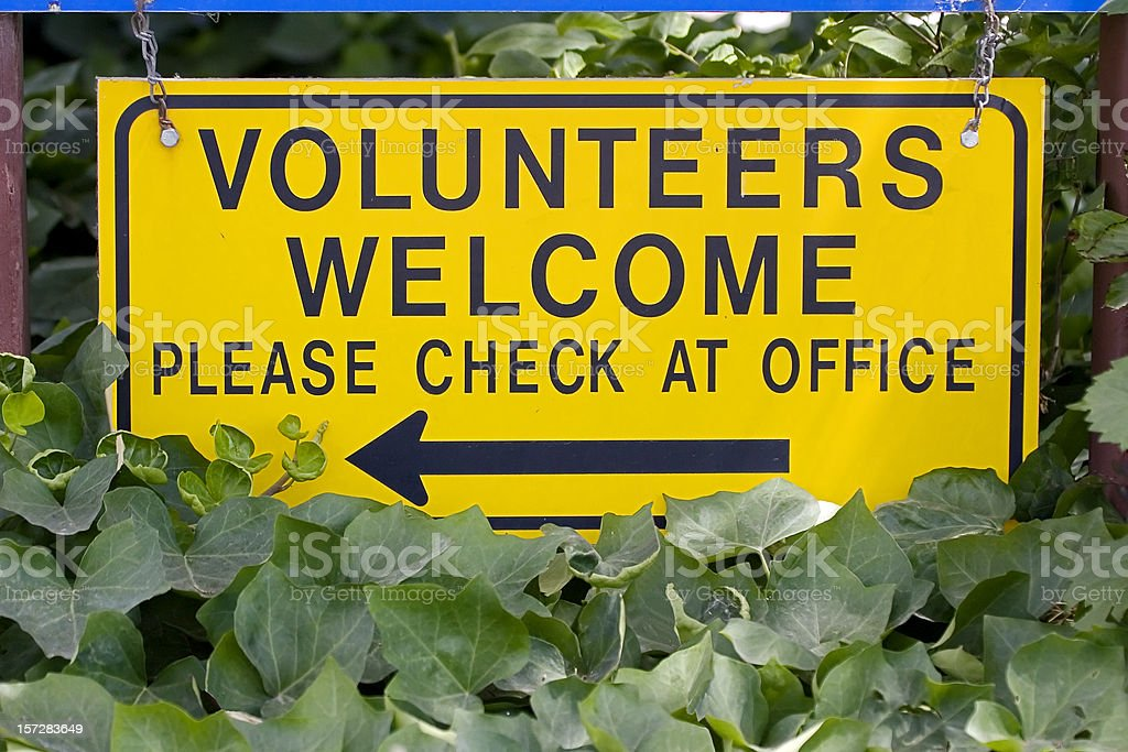Volunteers Welcome Sign, Please Check at Office. stock photo