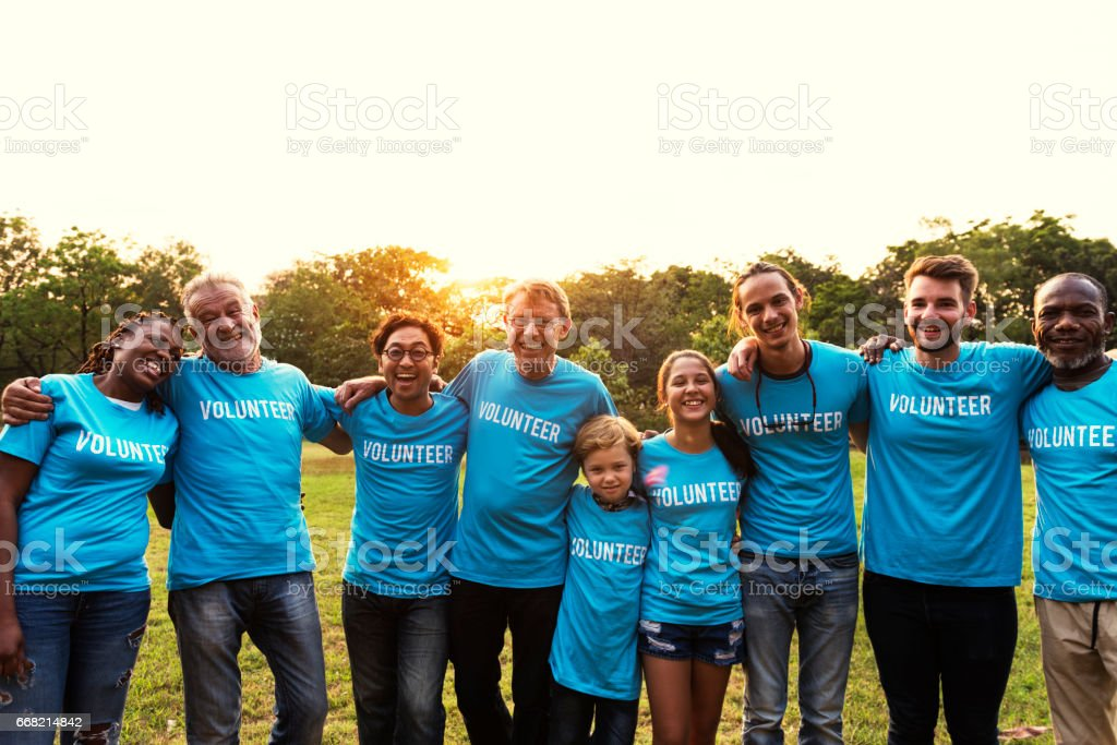 Voluteer group of people for charity donation in the park stock photo