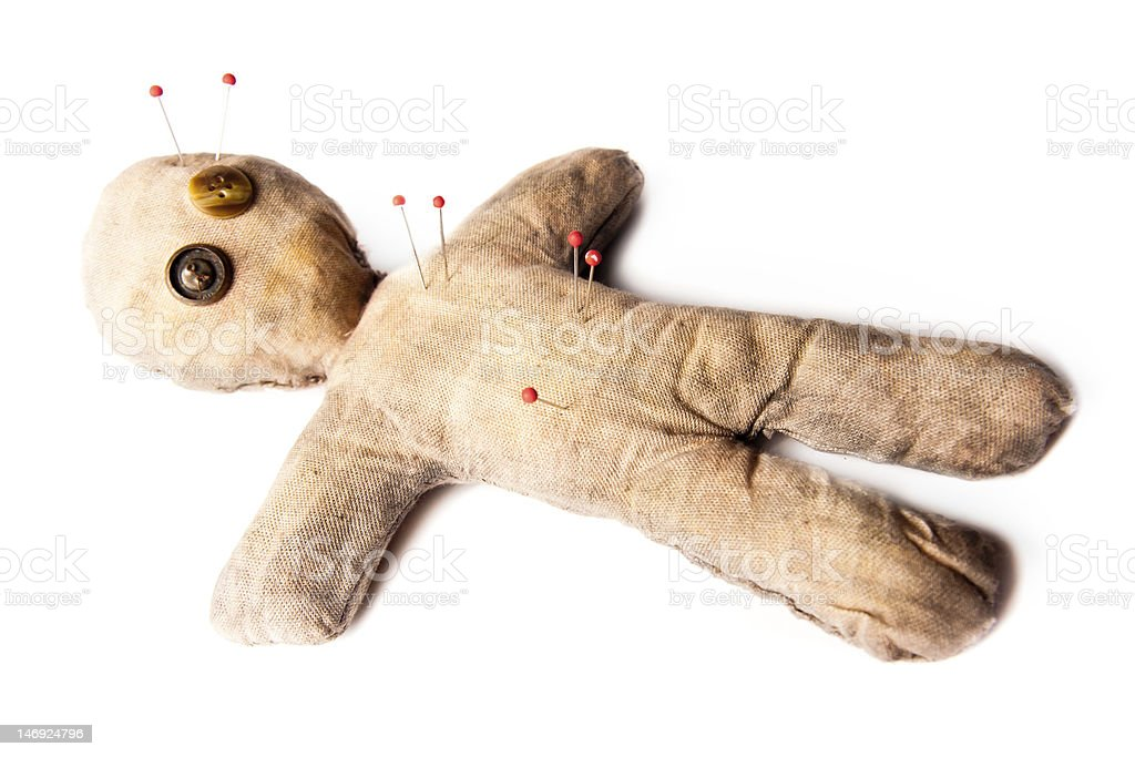 Voodoo doll isolated ground stock photo