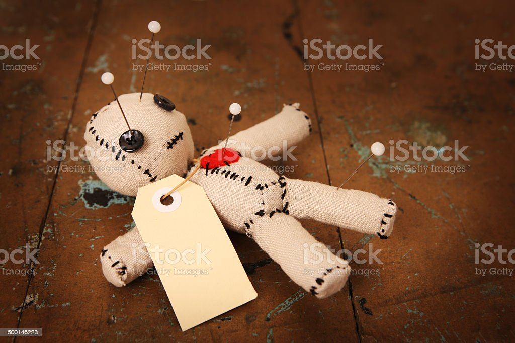 Voodoo Doll with Pins and Blank Tag stock photo