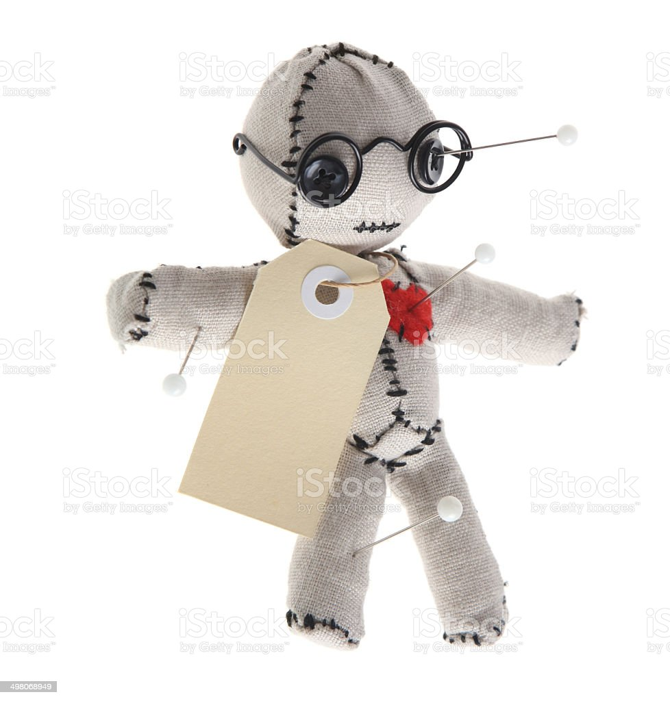 Voodoo Doll With Pins, Blank Tag and Glasses stock photo
