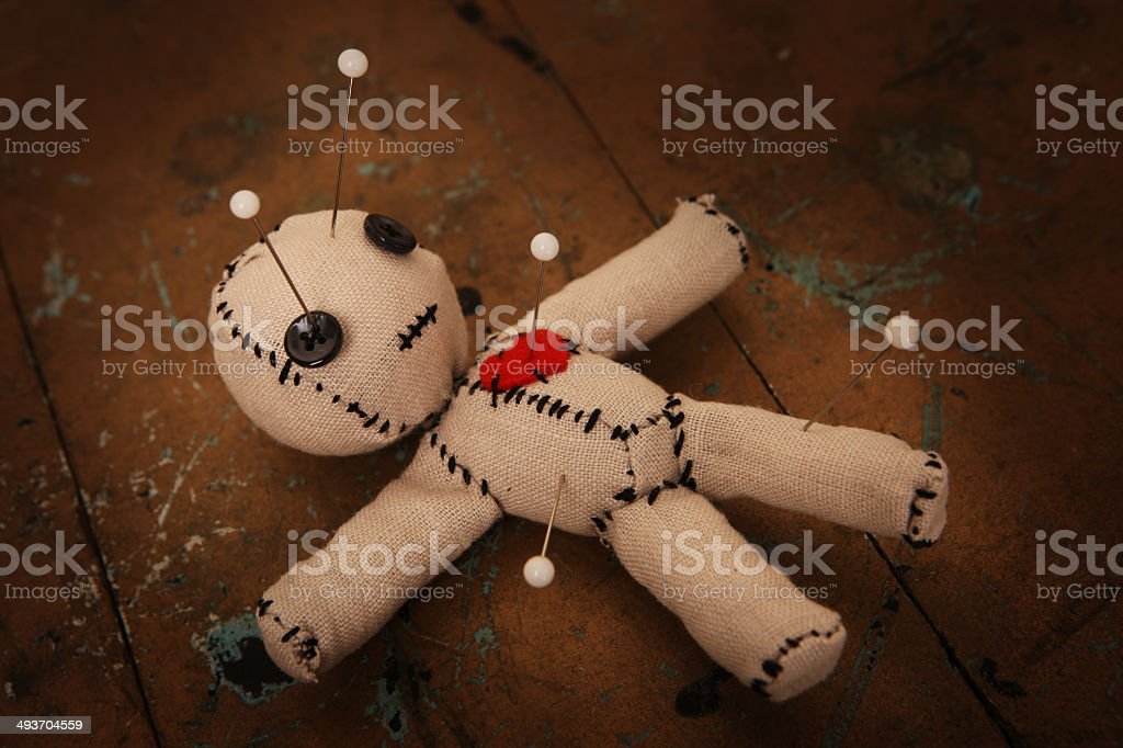 Voodoo Doll with Pins stock photo