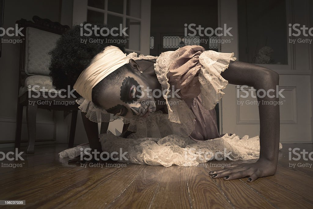 Voodoo Priestess crawling on the floor stock photo