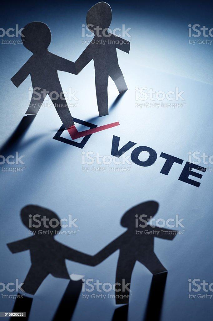 vote and Paper Chain Men stock photo