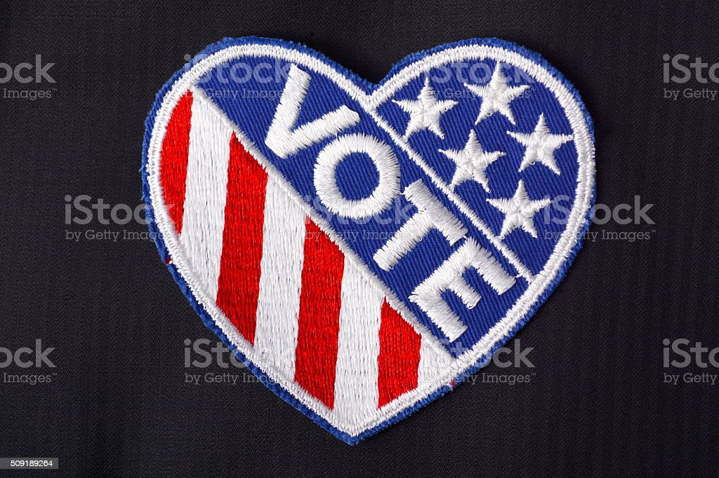 USA Vote Badge on suit pocket. stock photo