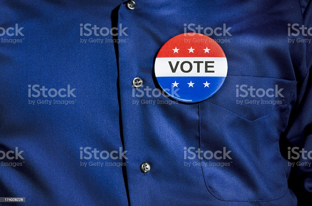 Vote Button on Blue Dress Shirt stock photo