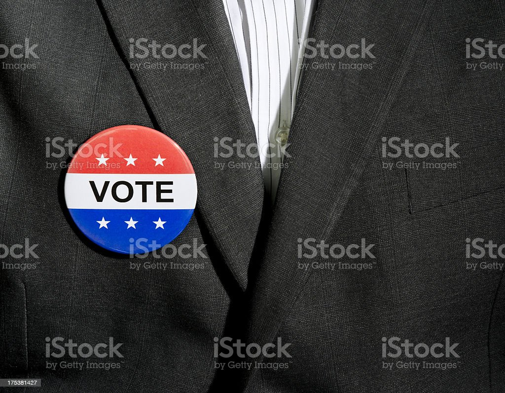 Vote Button on Charcoal Suit stock photo