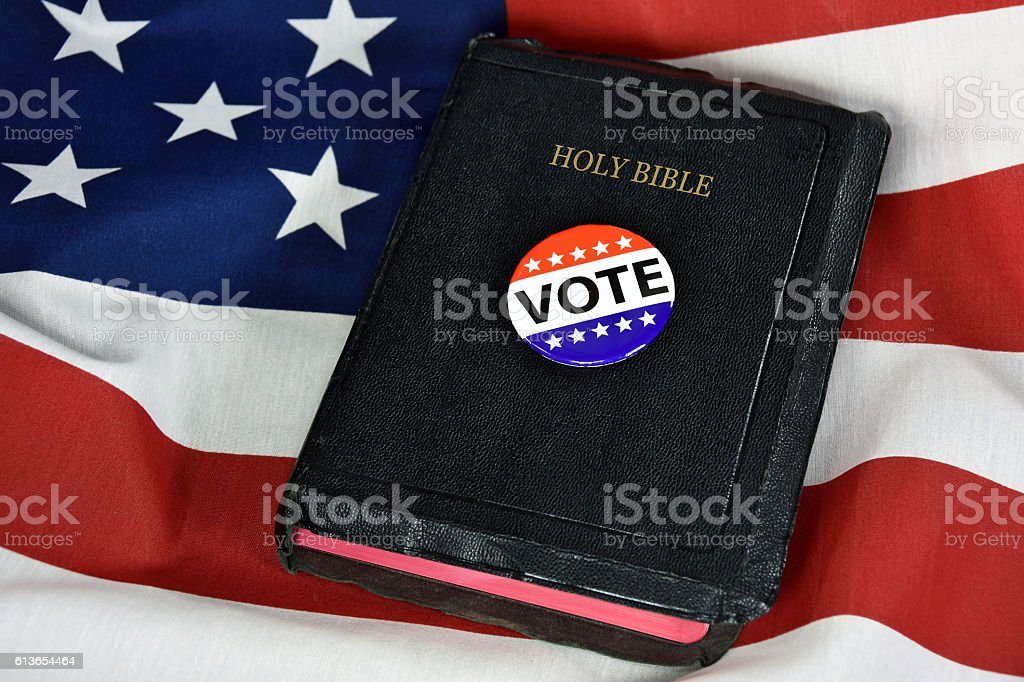 vote button on Holy Bible stock photo