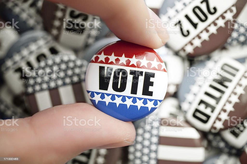 Vote button with desaturated buttons royalty-free stock photo