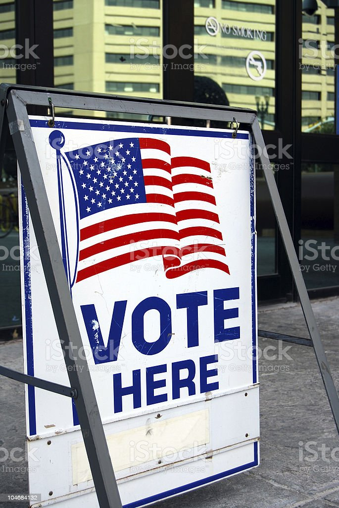 Vote here sign in downtown stock photo
