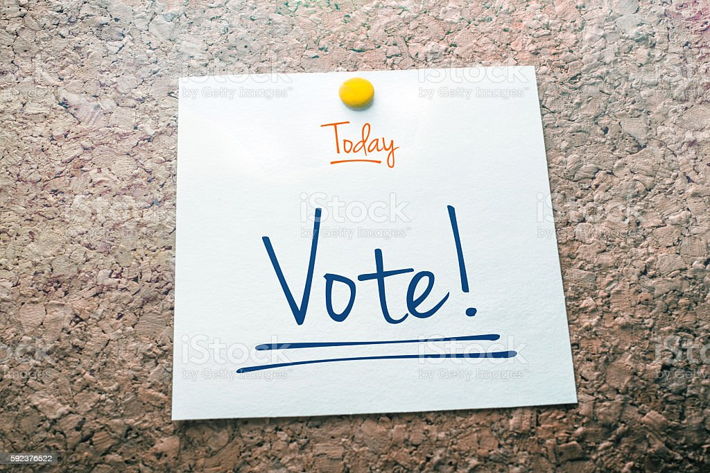 Vote Reminder For Today On Paper Pinned On Cork Board stock photo