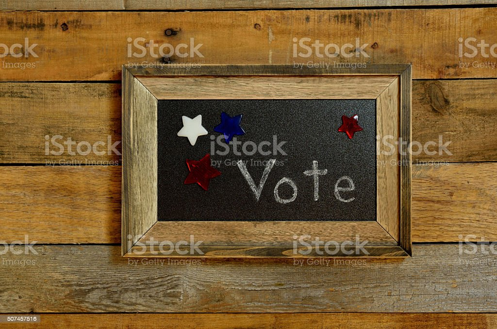 Vote script surrounded with red, white and blue stars. stock photo