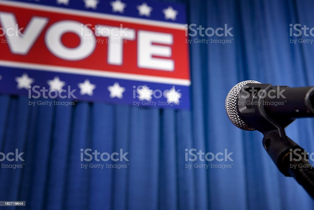 Vote Sign, Podium and an American Flag stock photo