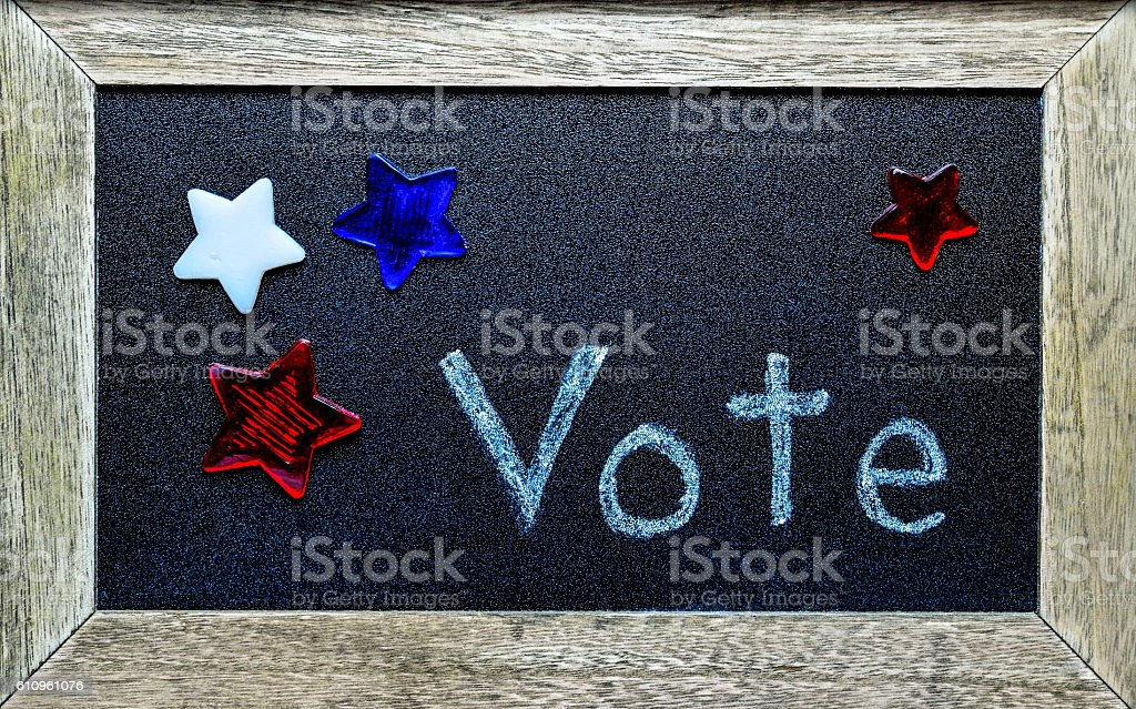 Vote, surrounded by red, white and blue stock photo