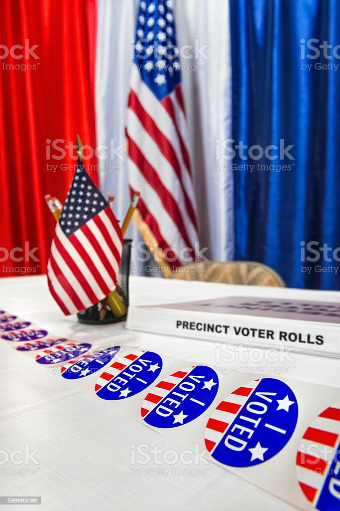 I Voted stickers ready at polling station registration desk stock photo