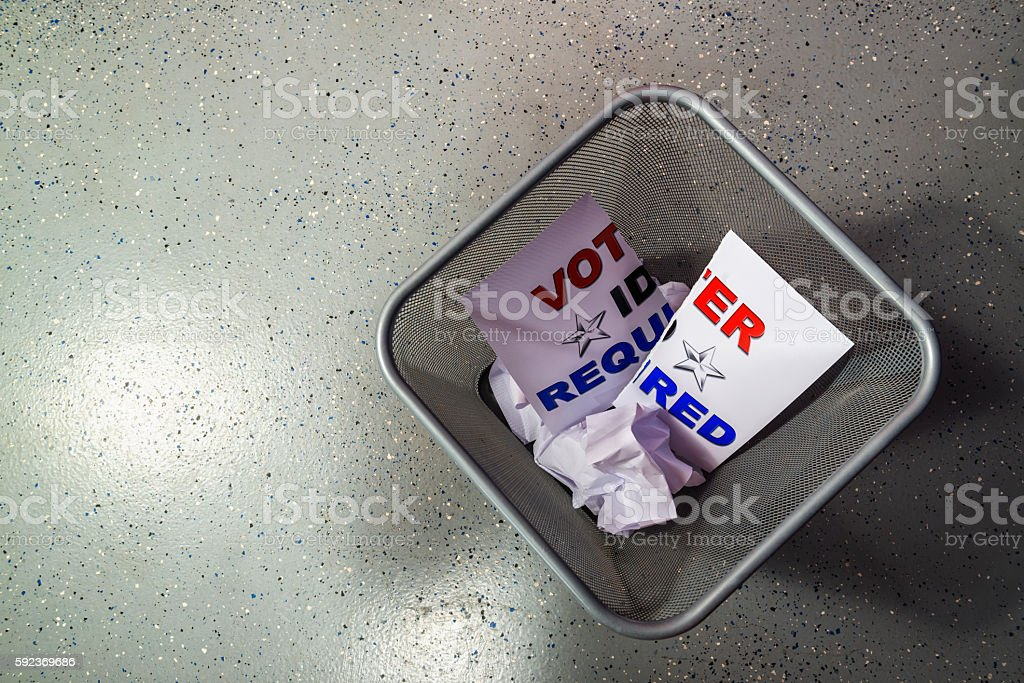 Voter ID Required sign in a metal  trash can stock photo