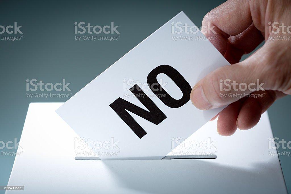 Voter Voting NO Ballot Over Ballot Box stock photo