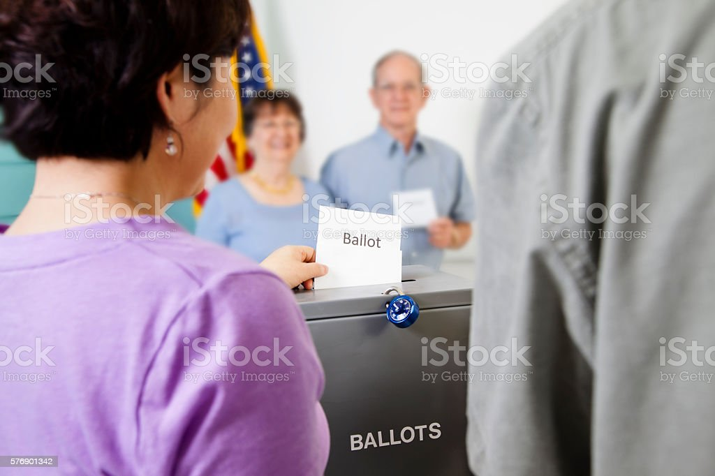Voters casting ballot in November United States elections.  Voting box. stock photo