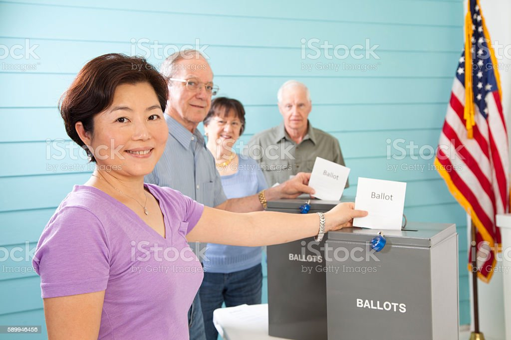 Voters casting ballot, voting in November United States elections. stock photo