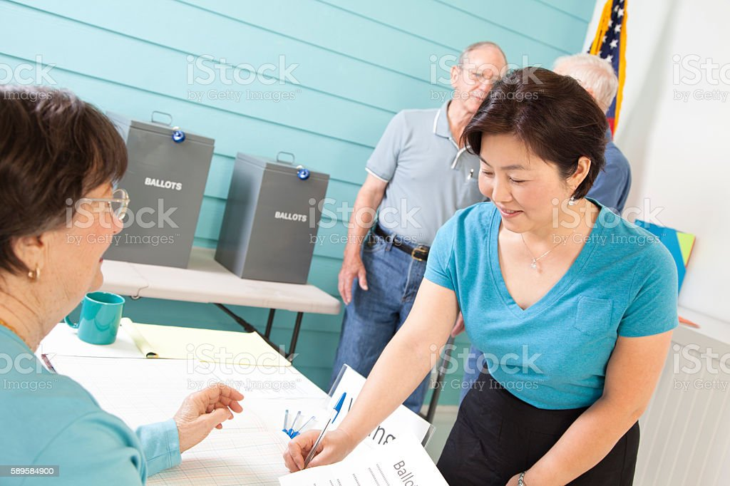 Voters registering, voting in the November United States elections. stock photo
